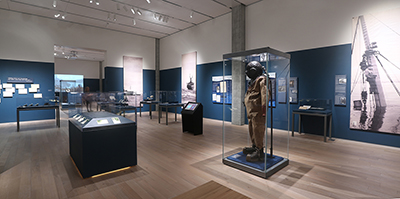 Wide view of pieces from the exhibition, including a diving suit.