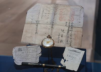 Artifacts from the Sophia: pocket watch, scope, registration.